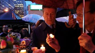 Toronto Mayor, John Tory, attends a candlelit vigil at the makeshift memorial a day after a van struck multiple people along a major intersection in north Toronto, Ontario, Canada, April 24, 2018.   REUTERS/Carlo Allegri