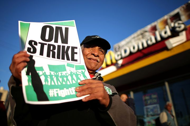"A worker participates in a ""Fight for $15"" wage protest in Los Angeles. The Birmingham City Council passed a measure in 2016"