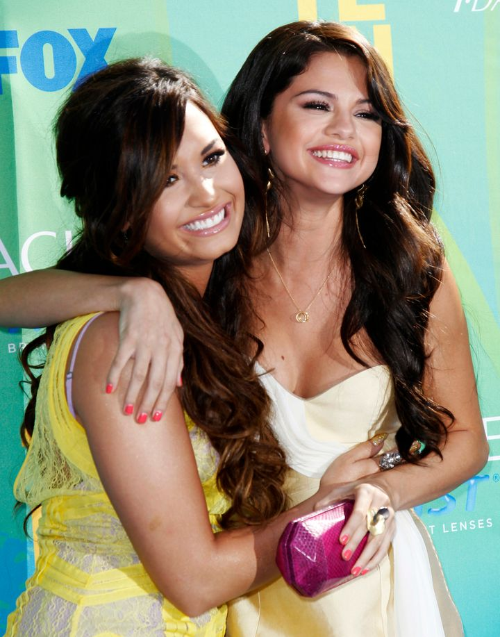 Demi Lovato and Selena Gomez pose together at the 2011 Teen Choice Awards.