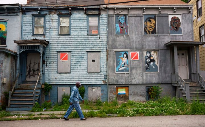 A man walks past boarded-up homes in Newburgh, New York, where massive PFOS contamination became the subject of multiple laws