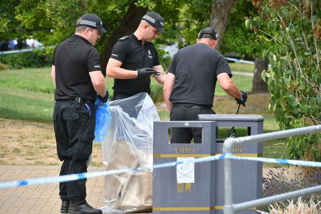 Police bag items as they conduct searches of Queen Elizabeth Gardens, Salisbury, where Dawn Sturgess...