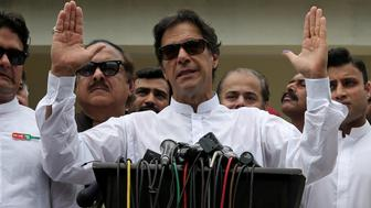 Cricket star-turned-politician Imran Khan, chairman of Pakistan Tehreek-e-Insaf (PTI), speaks to members of media after casting his vote at a polling station during the general election in Islamabad, Pakistan, July 25, 2018. REUTERS/Athit Perawongmetha      TPX IMAGES OF THE DAY