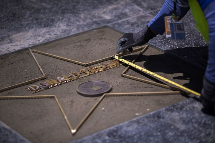 Workers were already hard at work to replace Trump's star after it was destroyed by a vandal on Wednesday.