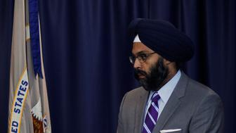 New Jersey U.S. Attorney Paul J. Fishman (C) speaks to the media next to U.S. Secret Service Special Agent James Mottola (L) and assistant New Jersey Attorney Gurbir Grewal during a news conference in Newark, New Jersey, July 25, 2013.  U.S. prosecutors have charged five foreign nationals with payment card theft resulting in more than $300 million in losses for companies in the U.S. and in Europe in what they described as the country's largest hacking fraud case in history. Victims include Nasdaq OMX Group Inc, Visa Inc, Dow Jones Inc, J.C. Penney Co, JetBlue Airways Corp and Carrefour SA, prosecutors said as they announced the indictments on Thursday. REUTERS/Eduardo Munoz (UNITED STATES - Tags: CRIME LAW BUSINESS)