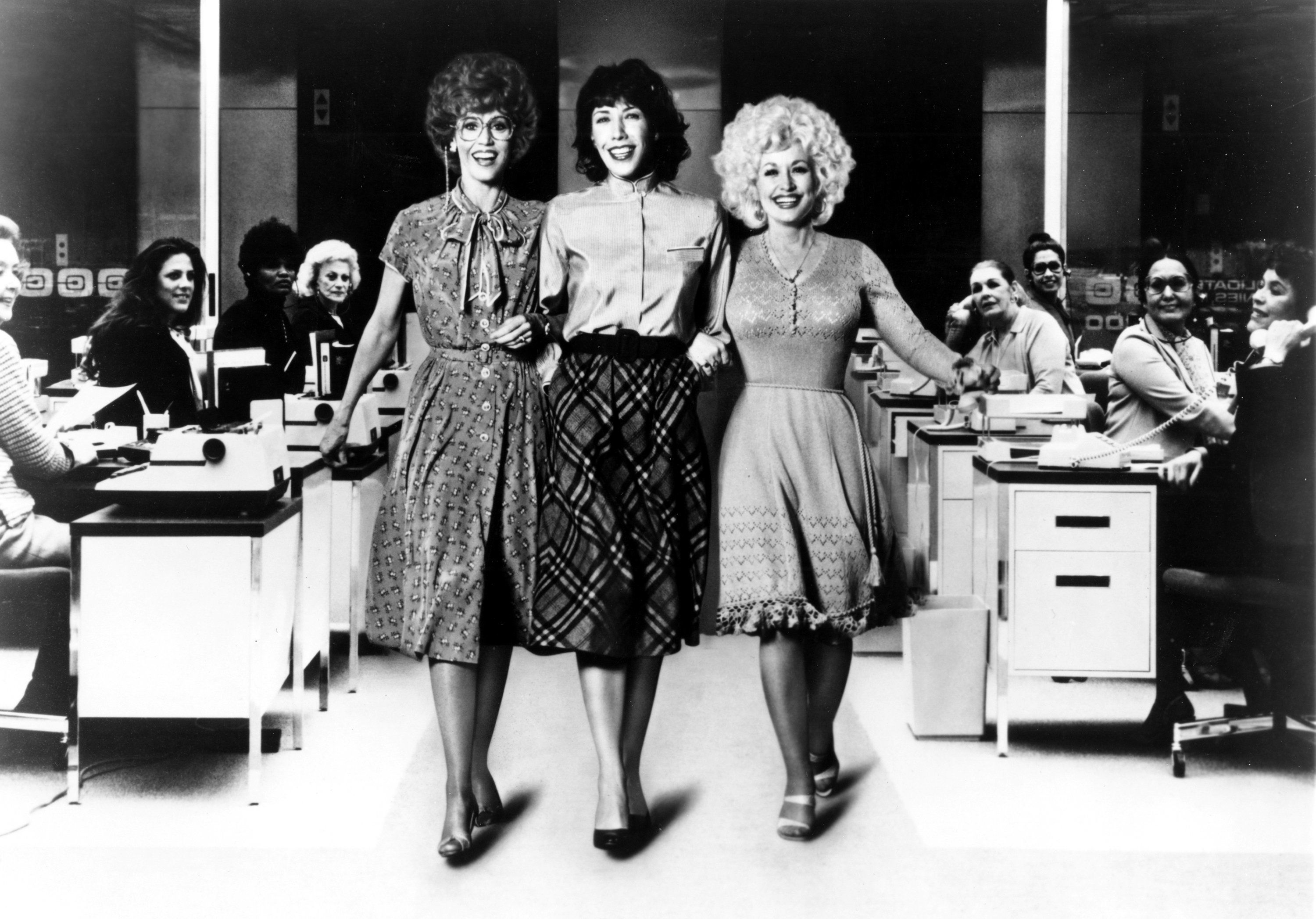 DECEMBER 19:  (L-R) Jane Fonda, Lily Tomlin and Dolly Parton act in a scene from the movie '9 to 5' which was released on December 19, 1980. (Photo by Michael Ochs Archives/Getty Images)