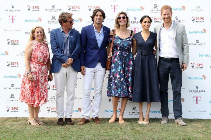 Sentebale CEO Cathy Ferrier, Sentebale Chairman Johnny Hornby, Sentebale Ambassador Nacho Figuares, wife Delfina Figueras, Meghan Duchess of Sussex and Prince Harry, Duke of Sussex pose together.