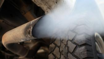 MIAMI - JULY 11:  Exhaust flows out of the tailpipe of a vehicle at , 'Mufflers 4 Less', July 11, 2007 in Miami, Florida. Florida Governor Charlie Crist plans on adopting California's tough car-pollution standards for reducing greenhouse gases under executive orders he plans to sign Friday in Miami.  (Photo by Joe Raedle/Getty Images)