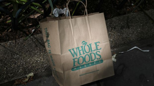 A Whole Foods Market bag is seen in Bryant Park in New York, U.S., May 10, 2017. REUTERS/Shannon Stapleton