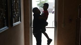 EL PASO, TX - JULY 25:  A man, identified only as Emiliano, spends time with his son, Hermy, 8, as they are cared for in an Annunciation House facility after they were reunited with each other on July 25, 2018 in El Paso, Texas. Emiliano and Hermy, originally from Guatemala, were reunited at an I.C.E processing center about two months after the two were separated when they tried to cross into the United States. It is unclear if a court-ordered July 26th deadline will be met for the U.S. government to reunite as many as 2,551 migrant children ages 5 to 17 that had been separated from their families.  (Photo by Joe Raedle/Getty Images)