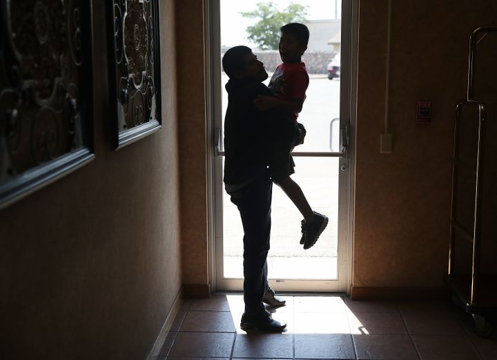 A man identified only as Emiliano spends time with his son, Hermy, 8, as they are cared for in an Annunciation House facility