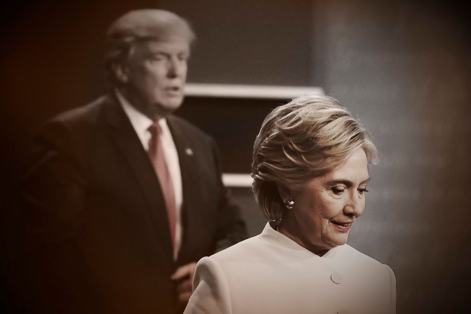 Democratic nominee Hillary Clinton and Republican rival Donald Trump walk off the stage after the...