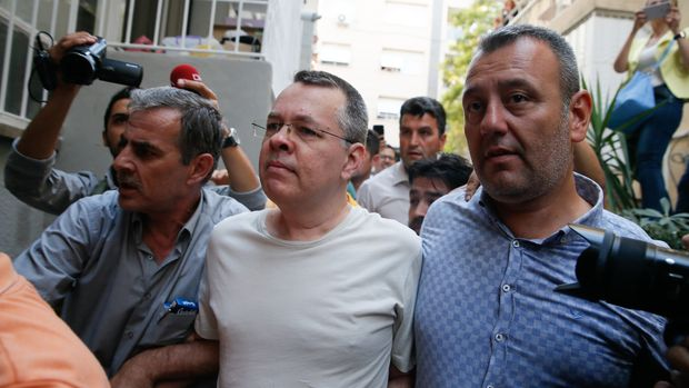 IZMIR, TURKEY - JULY 25: American Pastor Andrew Craig Brunson (C), who was charged with committing crimes, including spying for the PKK terror group and the Fetullah Terrorist Organization, arrives at the address, which he was put under house arrest due to his health problems, in Izmir, Turkey on July 25, 2018. (Photo by Evren Atalay/Anadolu Agency/Getty Images)