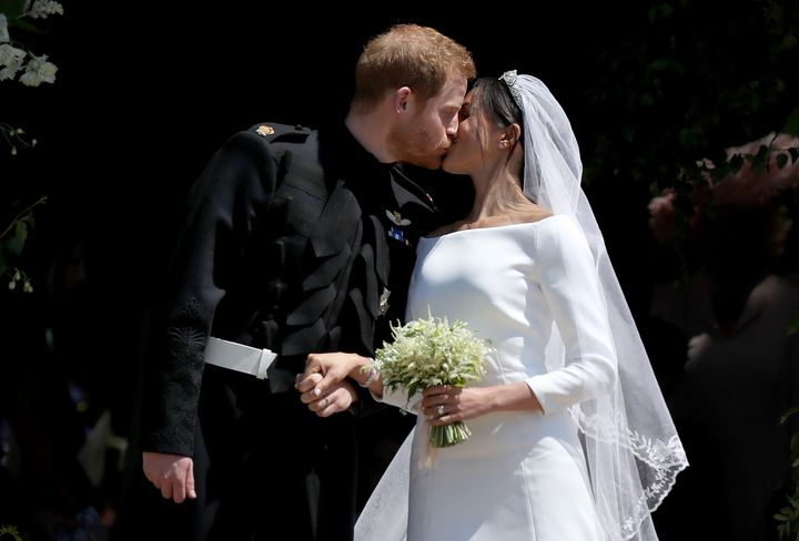 Prine Harry and Meghan, Duchess of Sussex, kiss outside St. George's Chapel in Windsors Castle, just after their wedding.&nbs