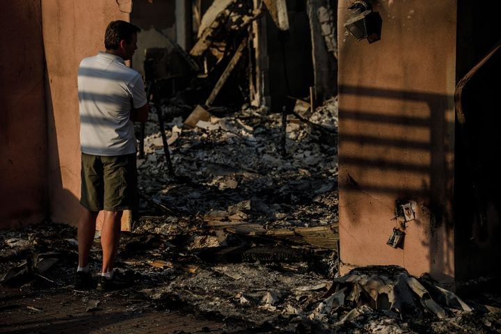 Eric Durtschi takes in the reality of his home destroyed by wildfire, in Goleta, California, on July 7.