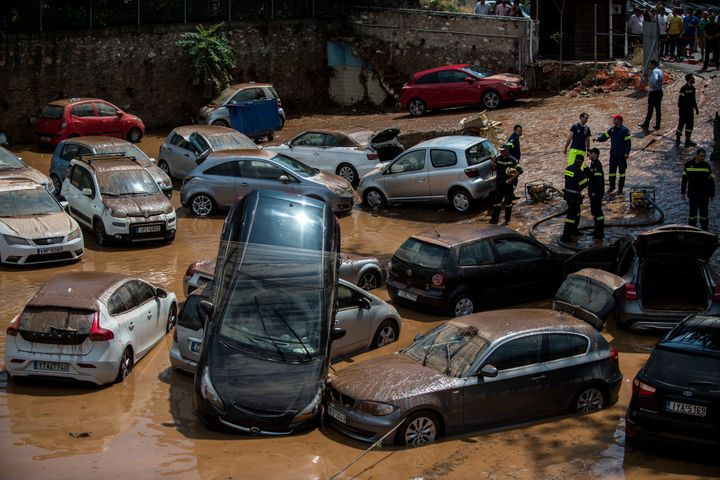 Vehicles are damaged in northern Athens on July 26, after a flash flood struck the Greek capital following deadly fires.