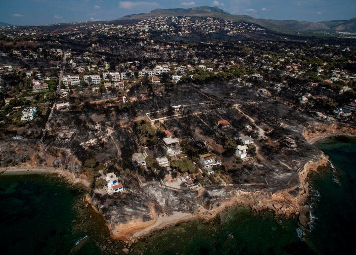 An aerial view shows a burnt area following a wildfire in the village of Mati, near Athens.