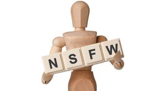 Wooden figurine with the letters NSFW isolated on white background