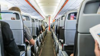 airplane with passengers on seats waiting to take offairplane with passengers on seats waiting to take off