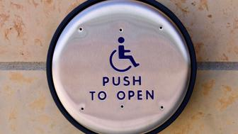 A handicapped push to open switch shows.
