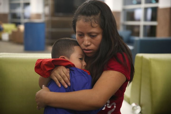 A Guatemalan woman is reunited with her son in El Paso, Texas, on July 26 after they were separated for a month under President Donald Trump's zero tolerance immigration policy.