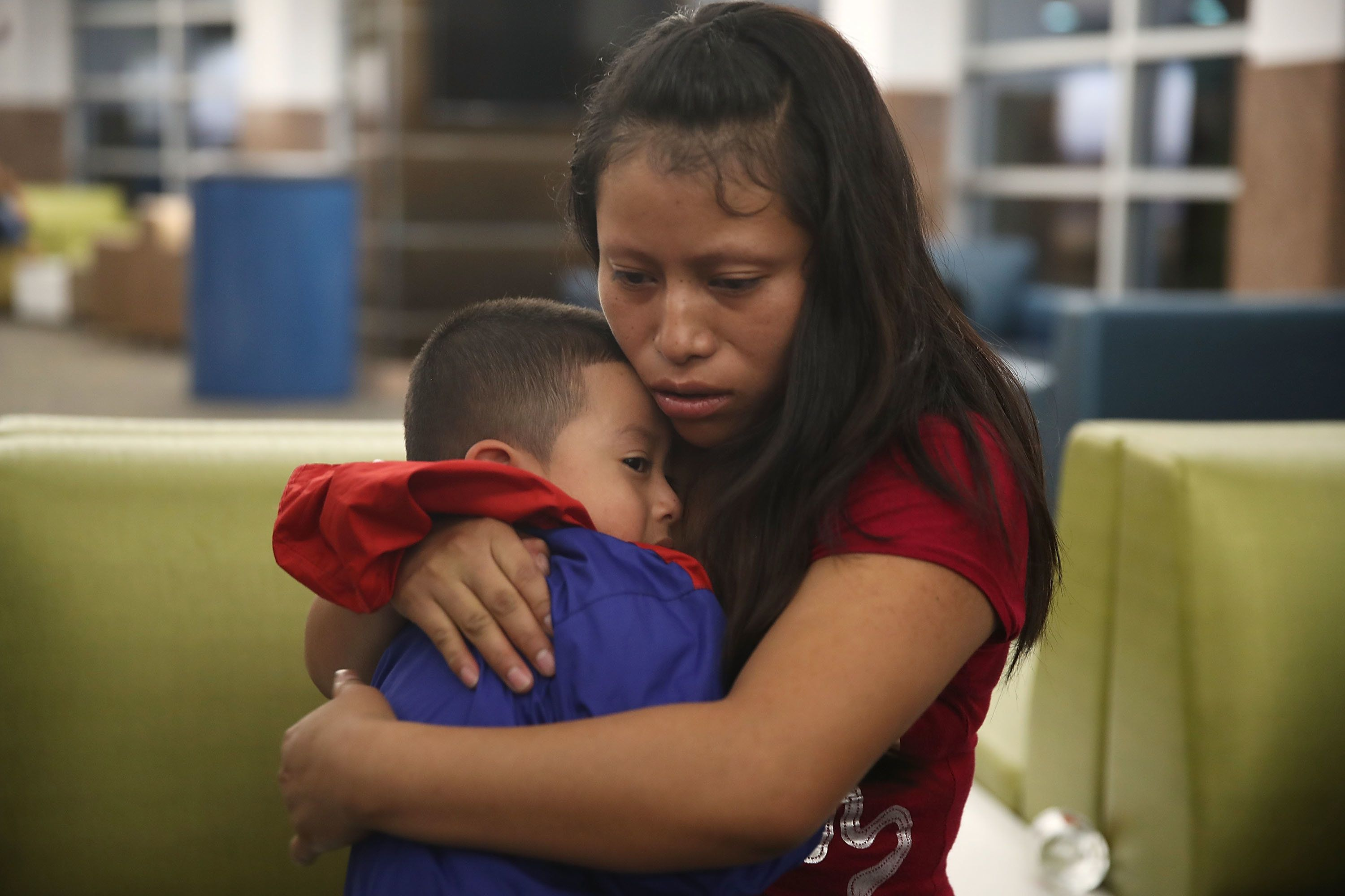 EL PASO, TX - JULY 26:  A woman, identified only as Maria, is reunited with her son Franco, 4,  at the El Paso International Airport on July 26, 2018 in El Paso, Texas. Maria, originally from Guatemala, was reunited with Franco, who was being held in New York, after being separated for one month when they  crossed into the United States. Today was a court-ordered deadline for the U.S. government to reunite as many as 2,551 migrant children ages 5 to 17 that had been separated from their families.  (Photo by Joe Raedle/Getty Images)