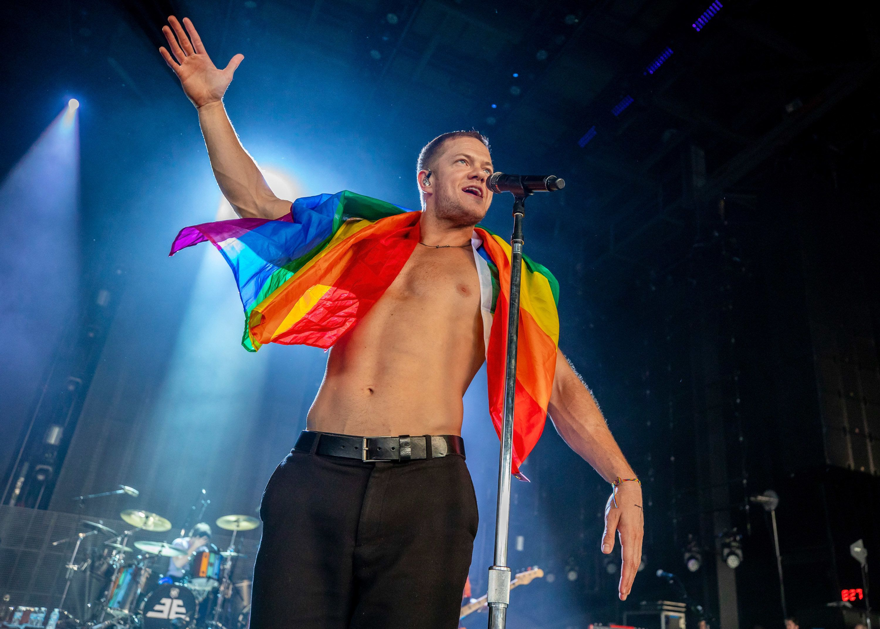 CLARKSTON, MI - JUNE 21:  Dan Reynolds of Imagine Dragons holds a gay pride flag during their Evolve World Tour 2018 at DTE Energy Music Theater on June 21, 2018 in Clarkston, Michigan.  (Photo by Scott Legato/Getty Images)