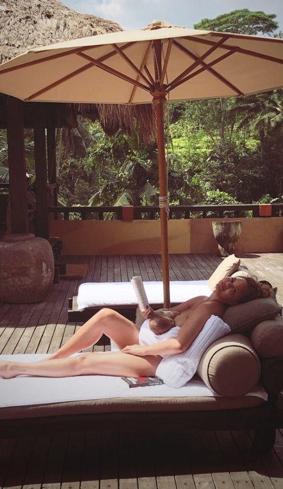Teigen nurses son Miles while relaxing in Bali.