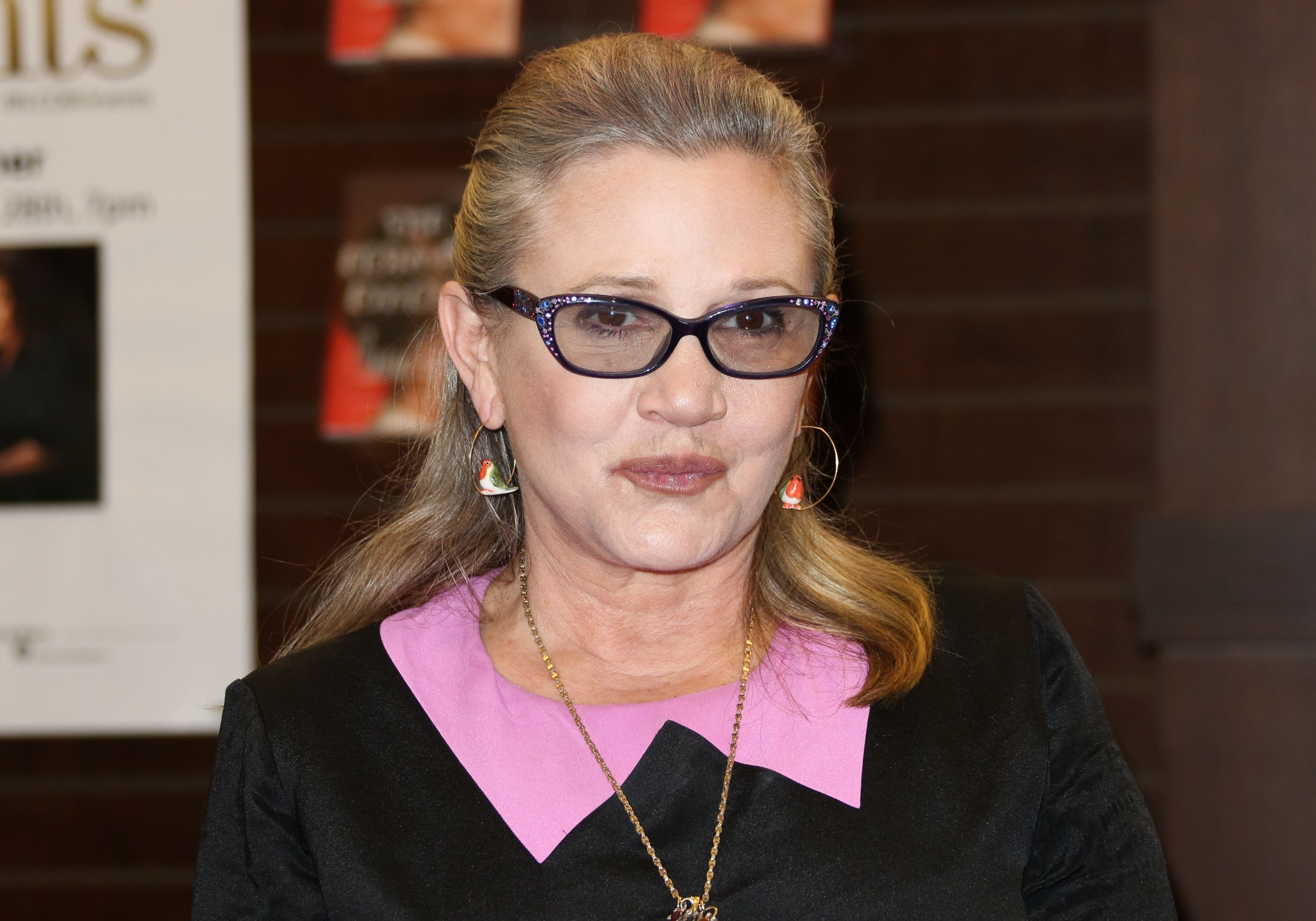 LOS ANGELES, CA - NOVEMBER 28:  Actress Carrie Fisher signs copies of her new book 'The Princess Diarist' at Barnes & Noble at The Grove on November 28, 2016 in Los Angeles, California.  (Photo by Paul Archuleta/FilmMagic)
