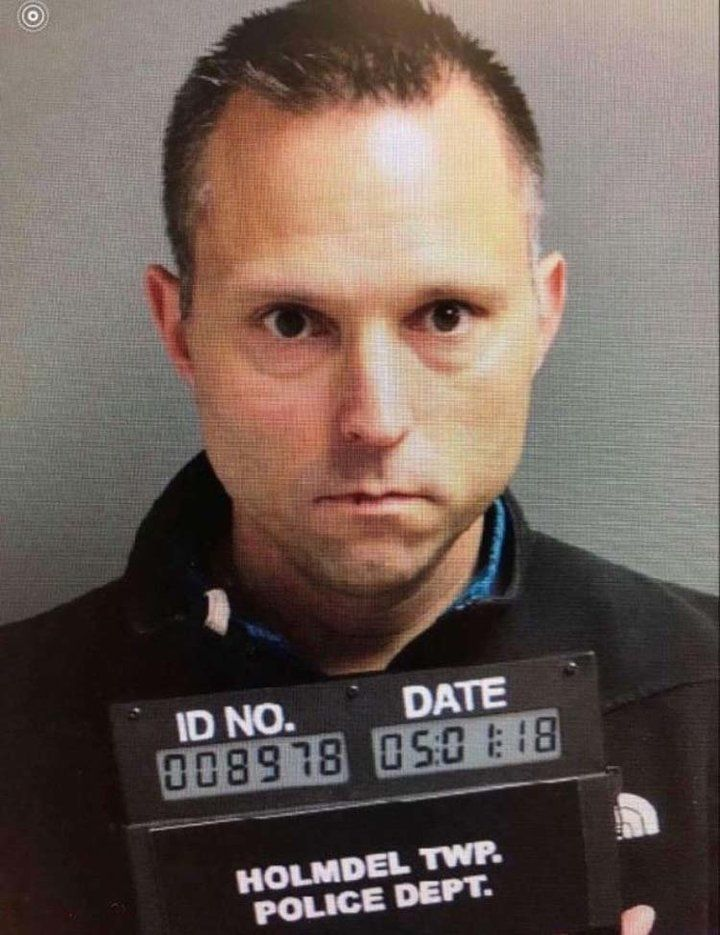 Former superintendent Thomas Tramaglini says he plans to file a lawsuit over this mug shot.
