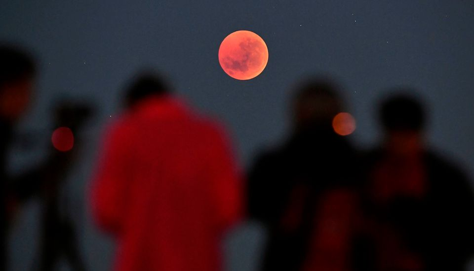 People gather to watch the moon in Melbourne,