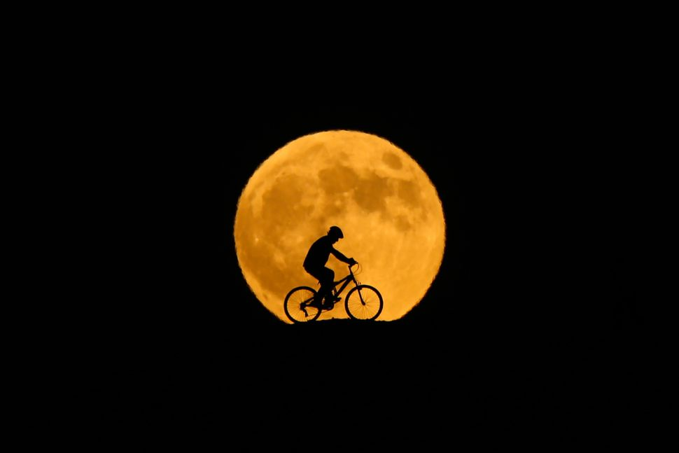 Behind the silhouette of a man riding a bicycle in Van, Turkey.