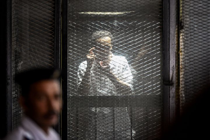 Egyptian photojournalist Mahmoud Abdel Shakour Abouzied, also known as Shawkan, makes a gesture mimicking taking a photograph