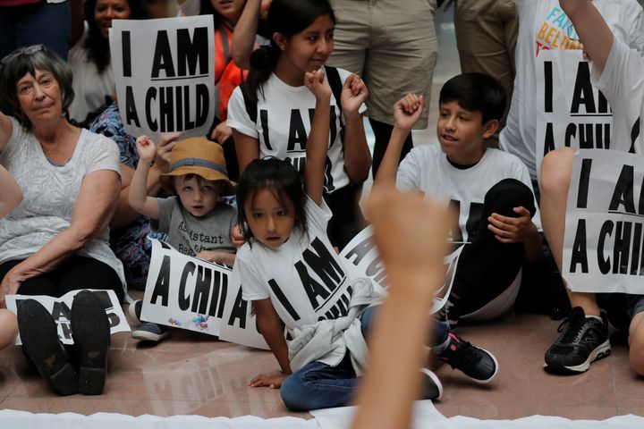 Children and parents participate in a protest in Washington against President Donald Trump's policy that separated immigrant