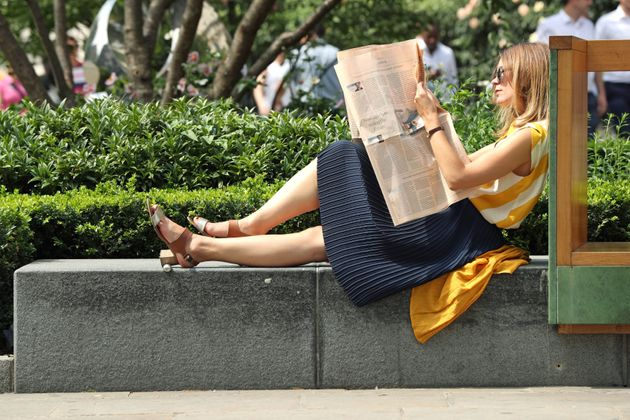 A woman relaxes in the heat in central London last week. Higher temperatures are predicted to return...