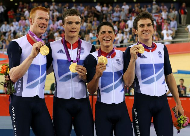 Thomas with Great Britain's Ed Clancy, Steven Burke and Peter Kennaugh celebrating with their gold medals...