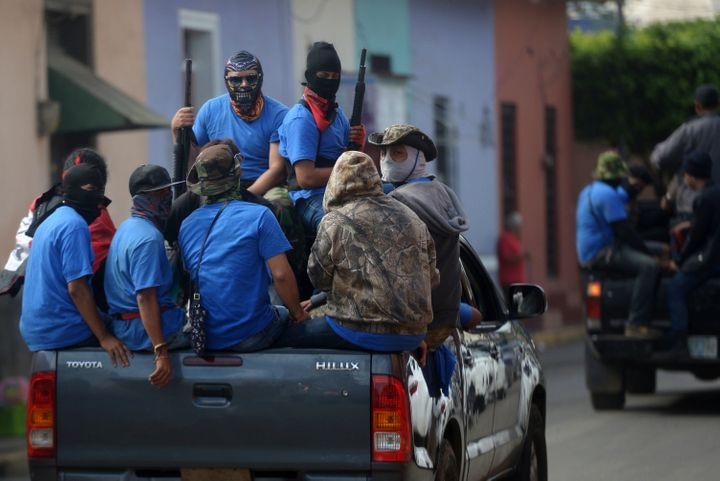 Members of a paramilitary group are seen in Masaya, Nicaragua, on July 18 following clashes with anti-government demonstrator