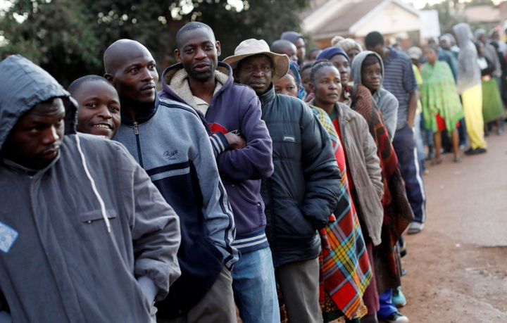 Voters lined up to cast their ballots in Zimbabwe's general elections in Harare on Monday.