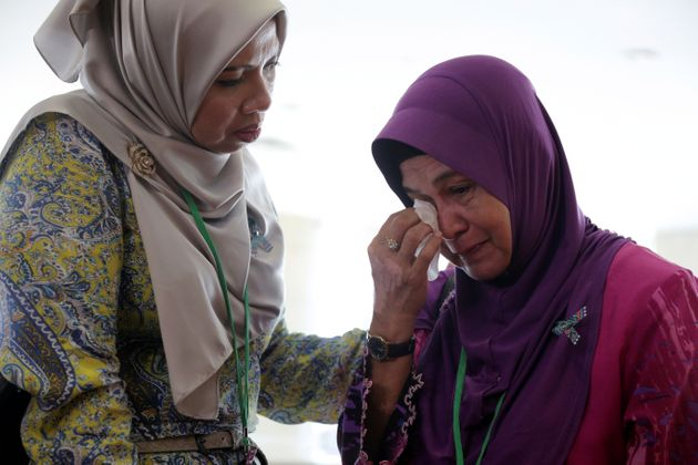 A family member wipes away tears following the release of the