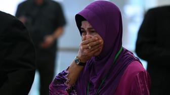 Sarah Nor, the mother of Norliakmar Hamid, a passenger on missing Malaysia Airlines flight MH370, cries as she arrives for the final investigation report on missing flight MH370 in Putrajaya, outside Kuala Lumpur on July 30, 2018. - Relatives of people aboard Flight MH370 said on July 30 they hoped a long-awaited report into the plane's disappearance might give them answers about one of the world's most enduring aviation mysteries. (Photo by Mohd RASFAN / AFP)        (Photo credit should read MOHD RASFAN/AFP/Getty Images)