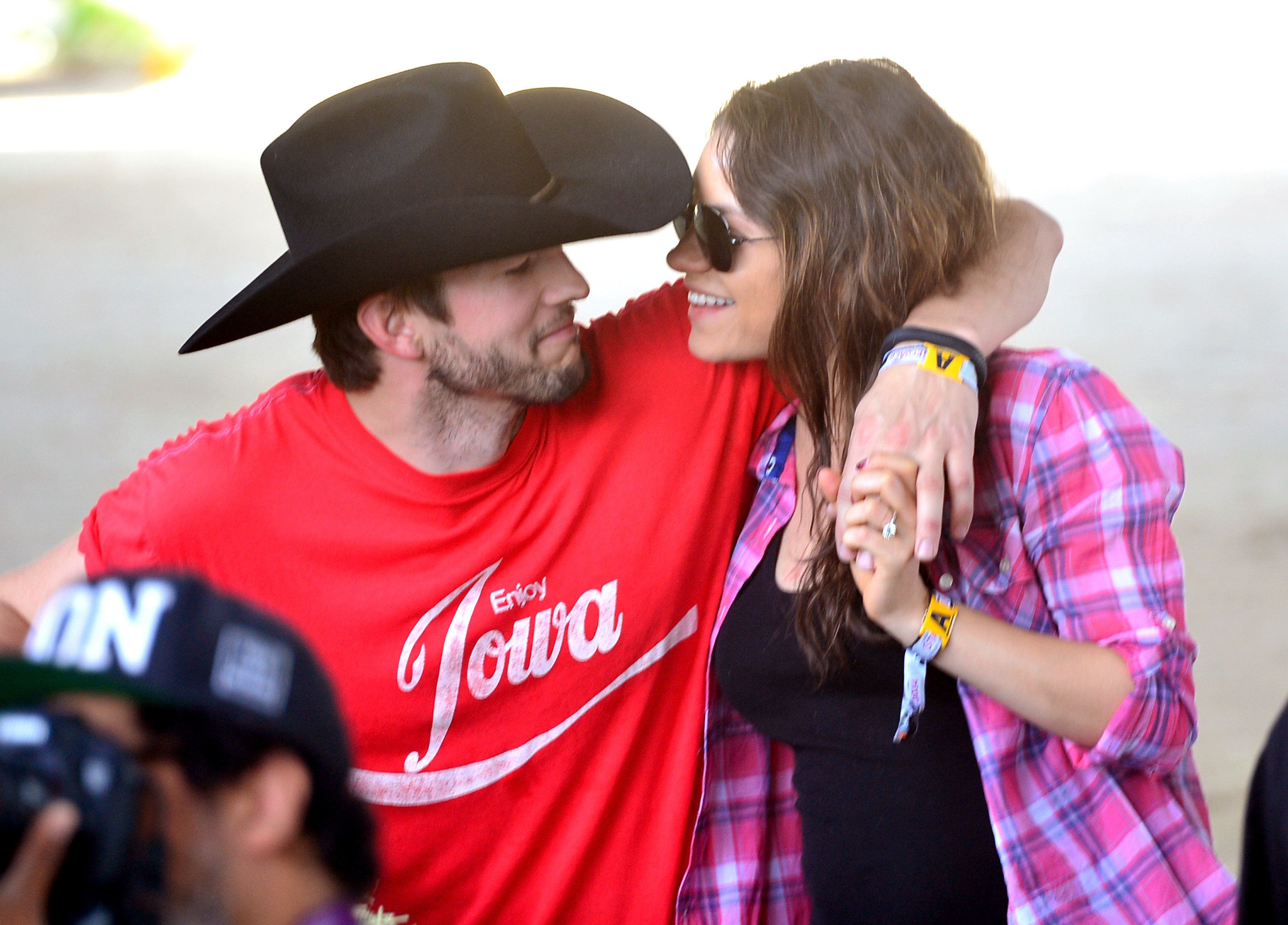 INDIO, CA - APRIL 25:  Actors Ashton Kutcher (L) and Mila Kunis attend day 1 of 2014 Stagecoach: California's Country Music Festival at the Empire Polo Club on April 25, 2014 in Indio, California.  (Photo by Frazer Harrison/Getty Images for Stagecoach)