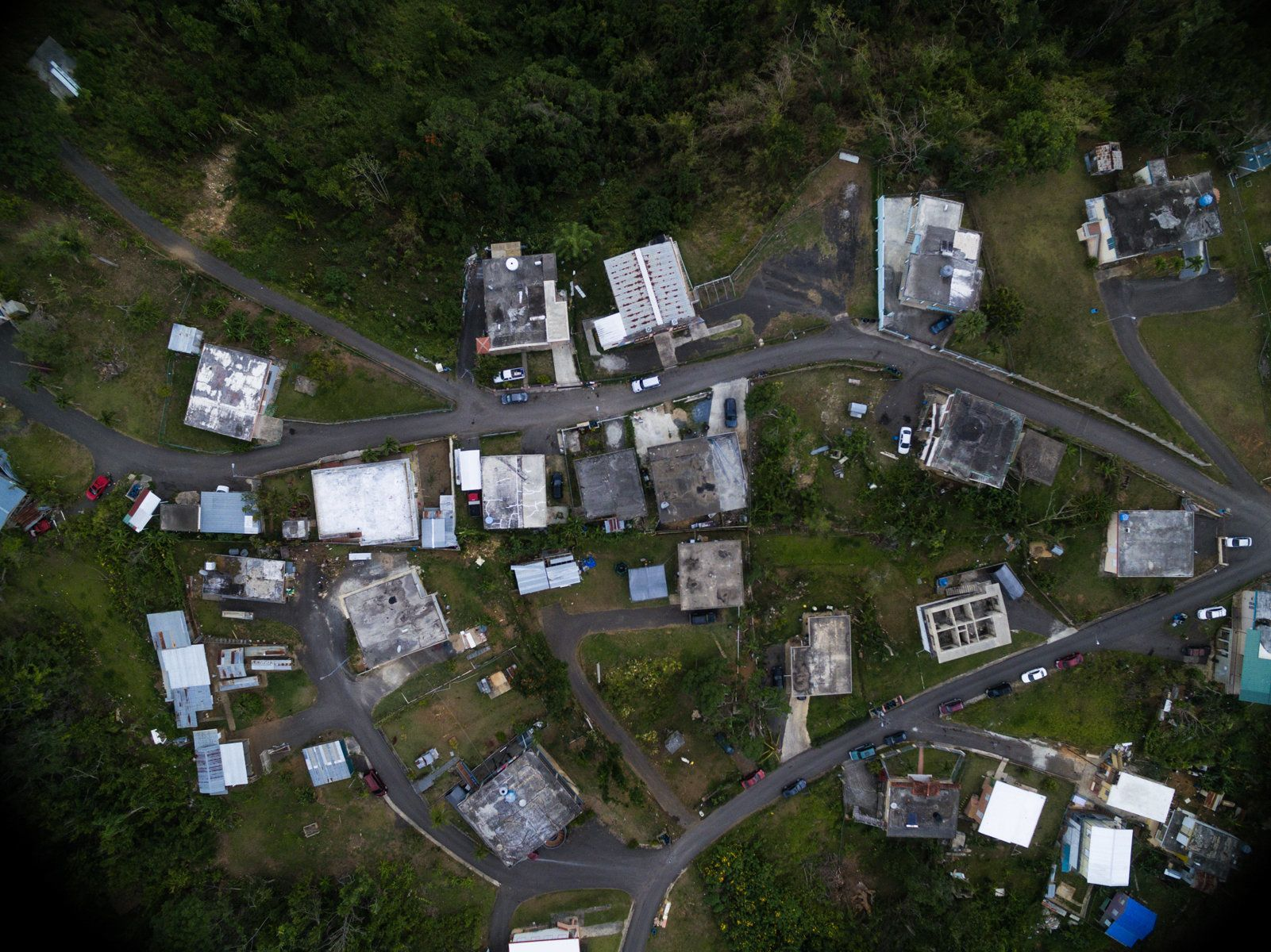 An overhead view of one of the communities Iniciativas De Paz serves reveals that some houses are entirely without roofs, and