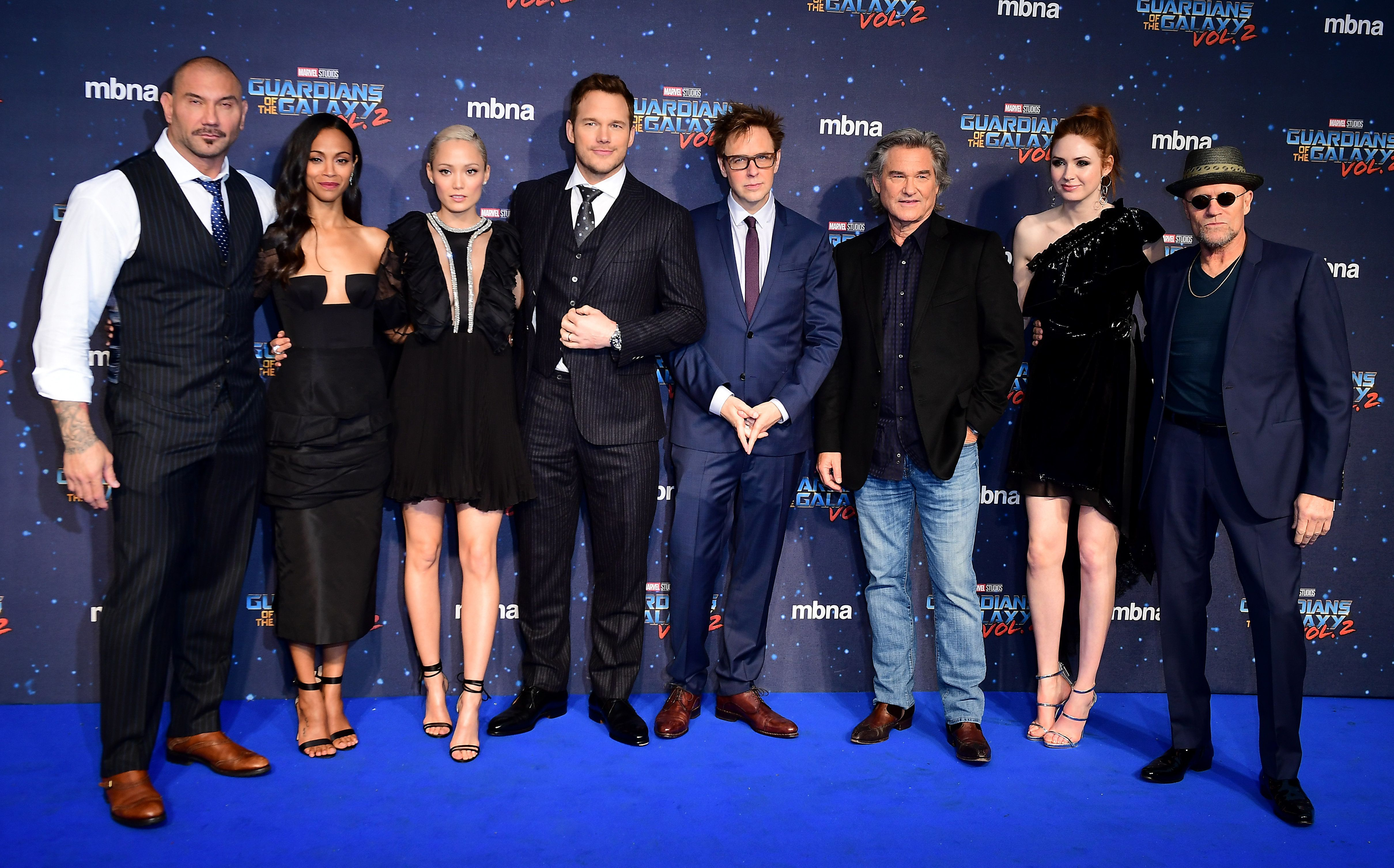 The cast (left to right) Dave Bautista, Zoe Saldana, Pom Klementieff, Chris Pratt, James Gunn, Kurt Russell, Karen Gillan and Michael Rooker attending The European Premiere of Guardians of the Galaxy Vol. 2 held at the Eventim Apollo, London.