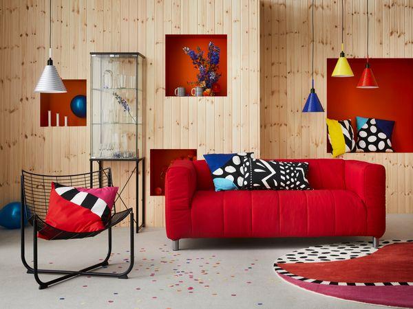 RÅANE armchair, $69.99<br>FÄRGSTARK glass-door cabinet<br>FÄRGSTARK pendant lamps, $24.99