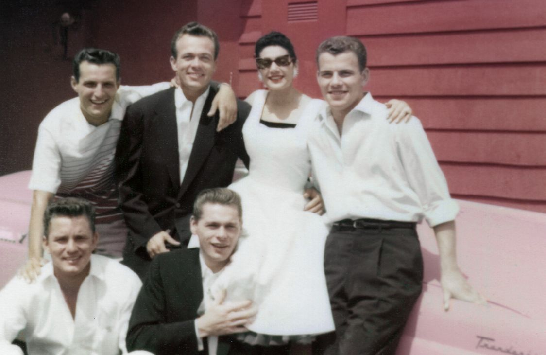 Scotty Bowers (top, secondfrom left) with some of his friends and escorts. In Los Angeles after World War II, he ran a