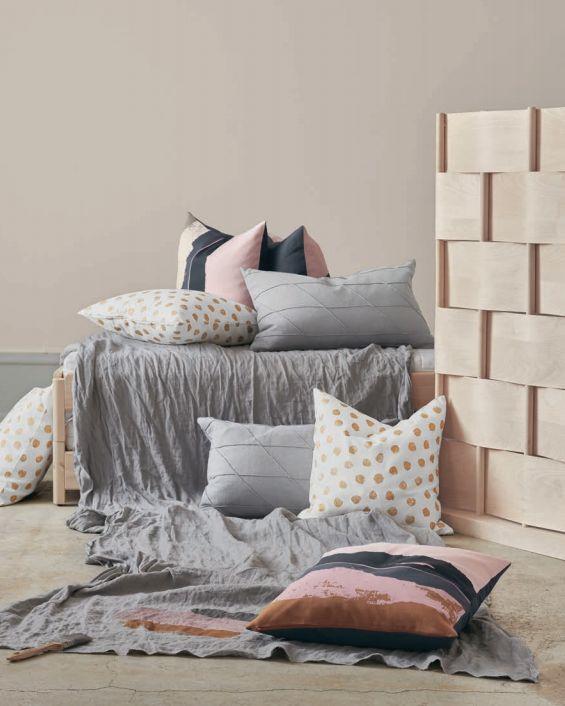 ELDTÖREL Cushion cover $6.99 (pink)<br>SKÄGGÖRT Cushion cover $6.99 (white)<br>HARÖRT Cushion $19.99 (gra