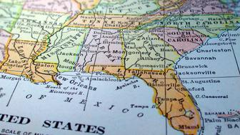 A dictionary map of the Southeast US. The photo was taken out of a one hundred + year old dictionary.