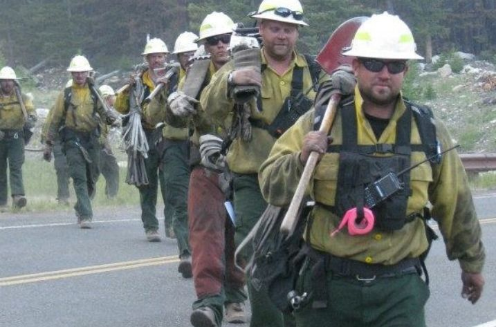 Jason Campbell (right) and his crew of firefighters after a shift fighting the Index Creek Fire in Wyoming's Shoshone Na