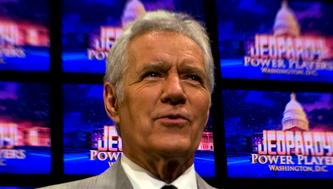 WASHINGTON, DC - APRIL 21:  Alex Trebek poses on the set of his game show Jeopardy on April 21, 2012. Mr. Trebek was in Washington for his 'Jeopardy! Power Players Week' shows which were being filmed inside DAR Constitution Hall. (Photo by Tracy A. Woodward/The Washington Post via Getty Images)