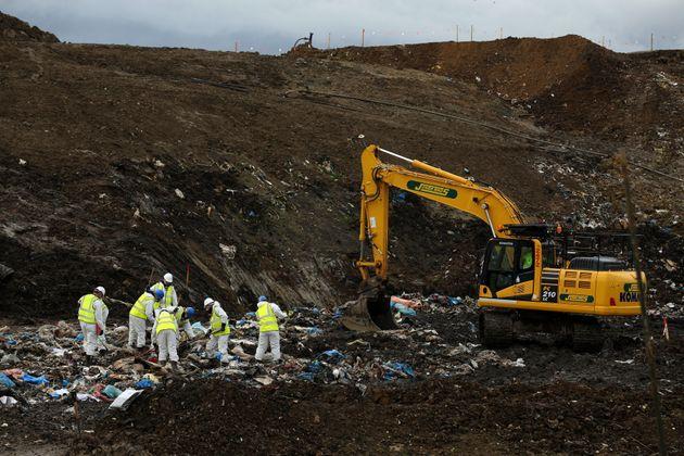 Police search a landfill site in Milton, Cambridgeshire, last
