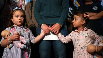 NEW YORK, NY - JULY 23: Sandra Chica, wife of Pablo Villavicencio, holds the hands of her children Luciana (L) and Antonia (R) during an advocacy rally and press conference in support of Pablo Villavicencio, who was arrested and detained in early June by Immigration and Customs Enforcement (ICE) after making a catering delivery to Fort Hamilton Army Base in Brooklyn, July 23, 2018 at City Hall in New York City. Supporters of Villavicencio plan to rally in his support outside of the federal courthouse during his court hearing on Tuesday morning. (Photo by Drew Angerer/Getty Images)